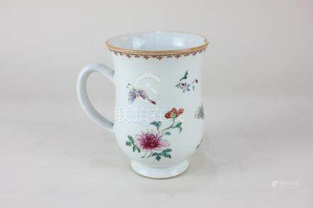 A Chinese porcelain tankard with butterfly and floral decoration (a/f), 14cm high