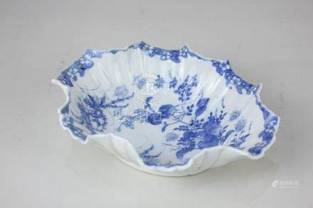 A Chinese porcelain blue and white dish of shaped oval form with scalloped edge, decorated with