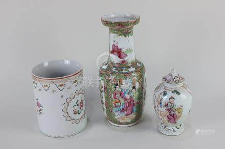 A Chinese Cantonese porcelain baluster vase with decorated panels of birds and butterflies and