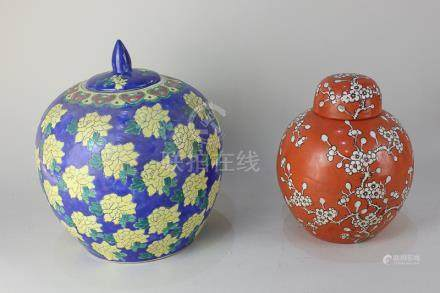 A Chinese porcelain ginger jar and cover, ovoid shape, decorated with yellow flowers on blue ground,