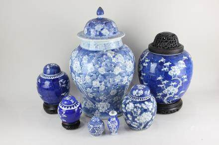 A Chinese porcelain blue and white ginger jar and cover, baluster shaped, decorated with prunus