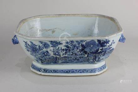 A Chinese porcelain octagonal dish, decorated with a fenced garden, with two lug handles, 30cm (a/