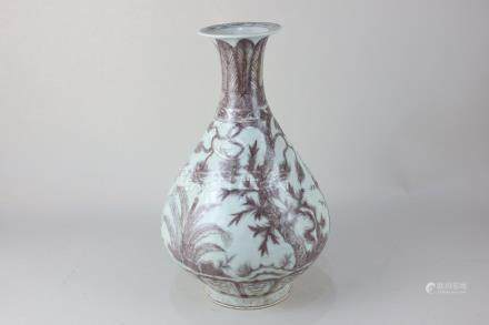 A Chinese porcelain bottle shaped vase with flared neck, decorated with red blossom and foliage on