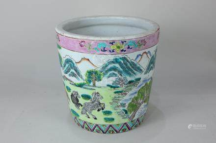 A Chinese porcelain jardiniere decorated with horses in a mountainous landscape, 20.5cm
