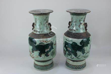 A pair of Chinese crackle ware celadon vases decorated with dragons and blossom branches,