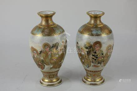 A pair of Japanese Satsuma ware baluster vases with polychrome and gilt figural decoration, marks to
