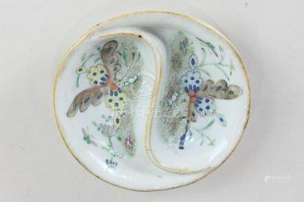 A Chinese porcelain dish, depicting butterflies in flight, with curved sectioning, seal mark to