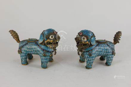 A pair of Chinese cloisonné models of Dogs of Fo, with coats decorated with simulated hair in shades