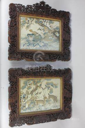 A pair of Chinese embroidered silk panels decorated with deer, birds, monkey and other animals,