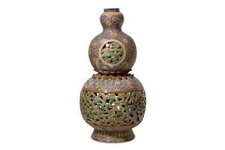 A Chinese 20th Century polychrome glazed double gourd vase, with pierced foliate decoration to the