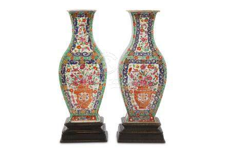 A pair of Chinese famille rose flower basket vases.