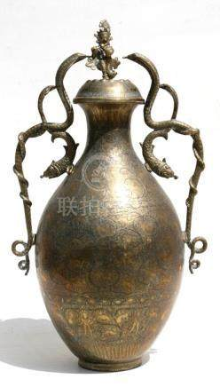 A large Indian brass two-handled vase and cover highly engraved with figures and foliate scrolls,
