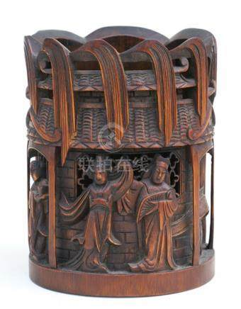 A Chinese bamboo brush pot decorated with figures, 18cms (7ins) high.