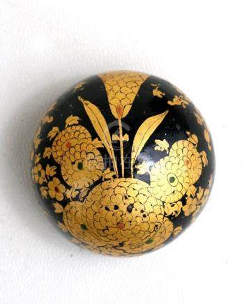 A 19th century Japanese lacquered scroll weight decorated with gilded flowers on a black ground, 5.