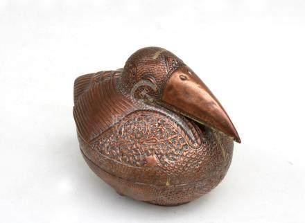 A Cambodian copper betal nut / leaf box in the form of a bird, decorated with foliate scrolls with