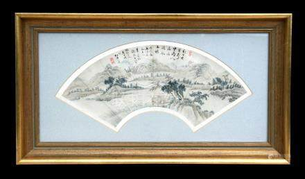 A 19th century Chinese fan leaf painting depicting a mountainous landscape scene with calligraphy