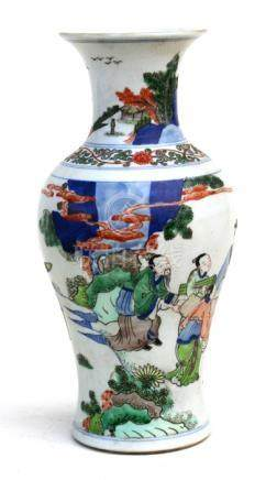 A Chinese baluster vase decorated with figures in a landscape, six-character blue mark to underside,