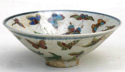 A Chinese footed bowl, highly decorated with butterflies, 17cms (6.75ins) diameter.