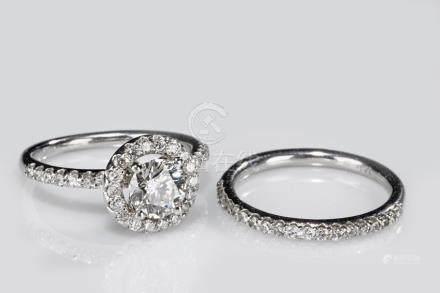 A SET OF TWO ITALIAN 14K WHITE GOLD DIAMOND RINGS