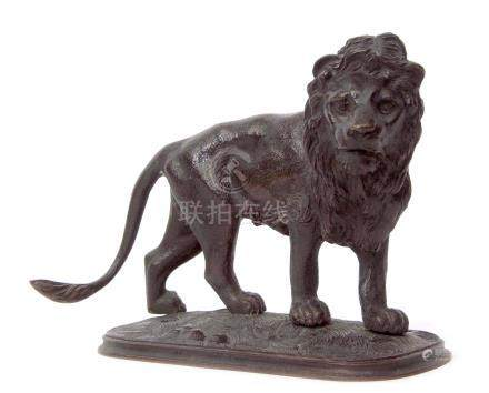 Japanese bronze model of a lion standing on an oval base, 16cm long