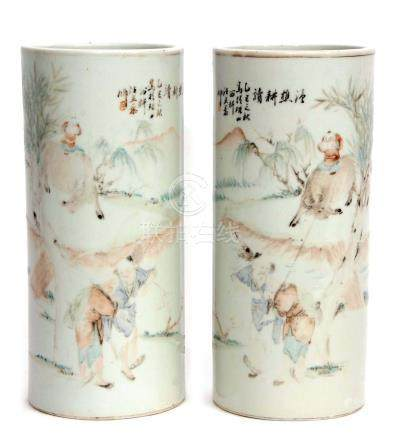 A pair of early 20th century Chinese porcelain vases of cylindrical form, with enamelled