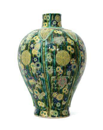 Chinese famille vert vase decorated in Kangxi style with bamboo and Buddhistic emblems, 36cm high