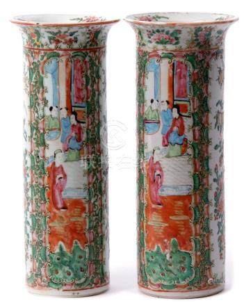 Pair of Cantonese cylindrical vases with typical enamelled decoration of alternating panels of