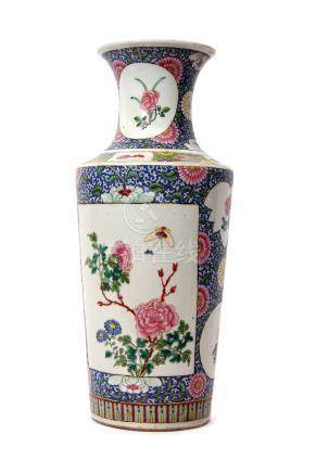 Chinese porcelain vase, probably 19th century, the blue scroll ground with panels decorated in