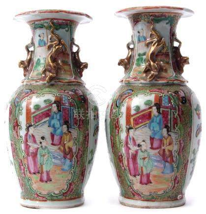 Pair of 19th century Cantonese vases with typical famille rose style decoration on a green and
