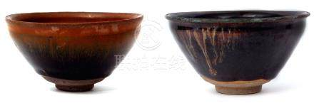 Two Japanese pottery bowls decorated with Tenmoku type glazes, one bowl complete with wooden box