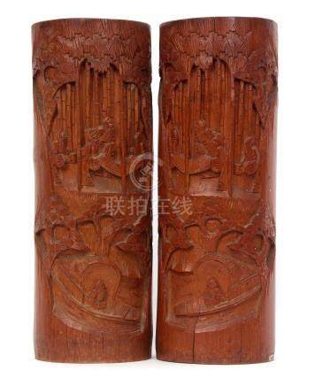 Pair of Chinese bamboo brush pots with typical carving of Chinese figures a various pursuits, 33cm