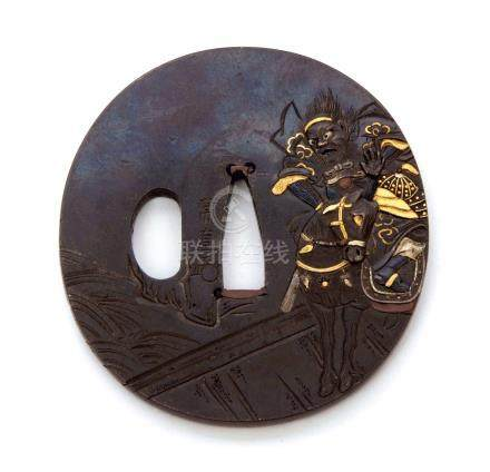 19th century Japanese oval iron Tsuba, decorated in gold with a warrior on horseback with battle