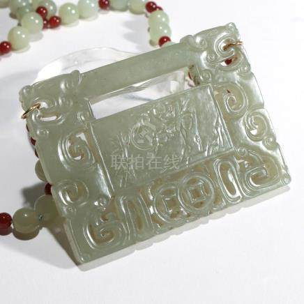 CHINESE JADE PLAQUE MOUNTED AS A NECKLACE
