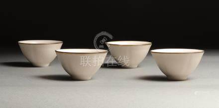 A SET OF FOUR XIAOFANG KILN WHITE-GLAZED TEA CUPS