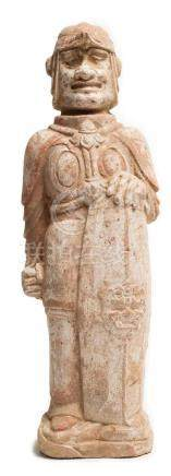A POTTER FIGURE OF HUMAN WITH SHIELD