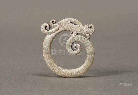 AN ARCHAIC WHITE JADE DRAGON-SHAPED RING