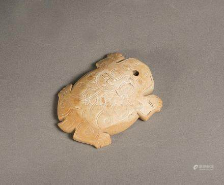 AN ARCHAIC CARVED JADE TURTLE