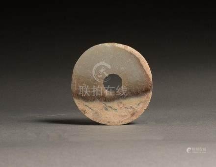 AN ARCHAIC WHITE JADE 'DRAGON' DISC, BI