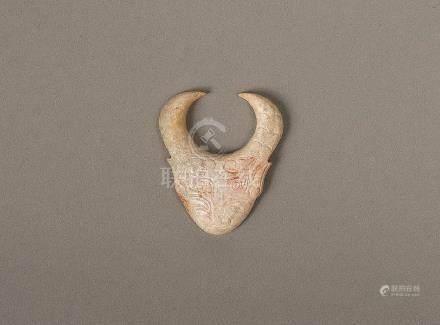 AN ARCHAIC JADE CATTLE HEAD