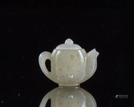 A Chinese jade miniature teapot. and cover