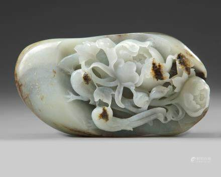 A Chinese white and russet jade 'pheasant and peony' pebble