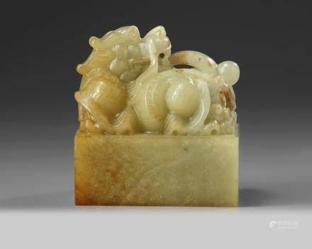 A large Chinese celadon jade 'dragon' seal