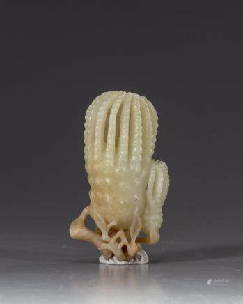 A Chinese pale celadon jade 'finger citron' carving