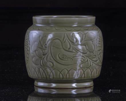 A Chinese celadon glazed jar