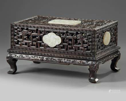 A Chinese white jade-inlaid carved box and cover