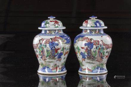 A pair of Chinese wucai glazed pots and covers