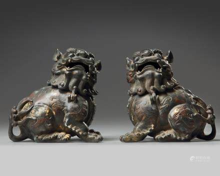 Two Chinese bronze figures of a fu lion
