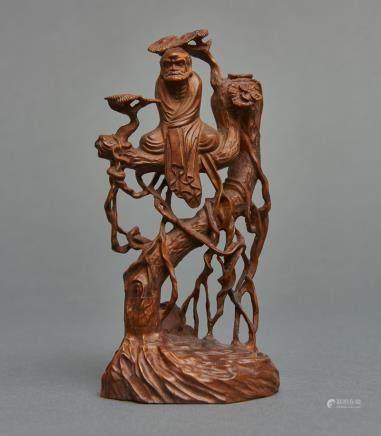 A boxwood carving depicting the Zen patriarch Daruma