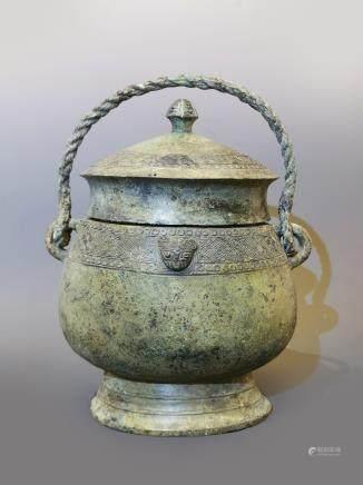 商晚期连珠纹青铜提梁卣
