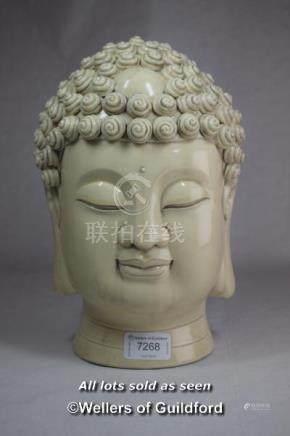 A Chinese blanc-de-Chine portrait bust of Buddha, impressed mark, 27cm